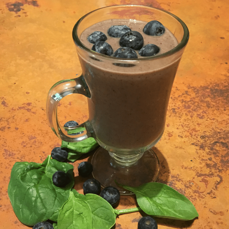 Wild Blueberries Smoothie with added greens. Beginner Green Smoothies with spinach, wild blueberries, strawberries and avocado